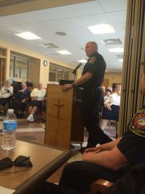 Captain Risell presenting at Camilla Hall