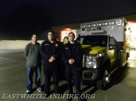 (L to R) LifeLine sales representative Allan Wallace, EMS Lieutenant Quintin Lotz, and EMT Nick Melchiorre in front of new ambulance at Station 5.