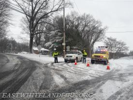 East Whiteland Fire Police closing Charlestown Road at Pikeland Road in Charlestown Township.