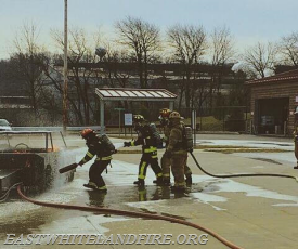 The crew works together to safely and properly extinguish the fire.