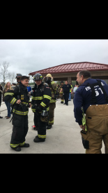 Junior Firefighter Jake Wilson (far left) with East Whiteland Deputy Fire Chief Mark Koenig (far right) at the Chester County Training Campus.
