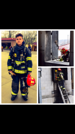 Jake Wilson holding his red helmet which denotes a junior firefighter with the East Whiteland Fire Company during training.