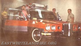 An ambulance was borrowed from Wolfington Body Company to convince the community that an ambulance was needed in East Whiteland. Original committee members were (L to R) Firefighter Tommy Cockerham, Firefighter Randy Cockerham,  Firefighter/Engineer and Committee Chairman Bill Gatlos, and Assistant Fire Chief Bobby Hovanietz.