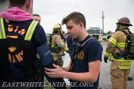 Firefighter Jake Kelly takes vitals of firefighter Kyle O'brien after going into one of the burn buildings at the West Chester Fire Department Training Center.