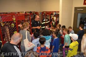 East Whiteland Career Captain Greg Lewis explaining the various gear that firefighters wear to keep them safe.