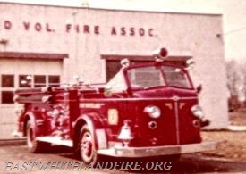 The chrome bell mounted on the front of the 1947 American LaFrance fire engine.