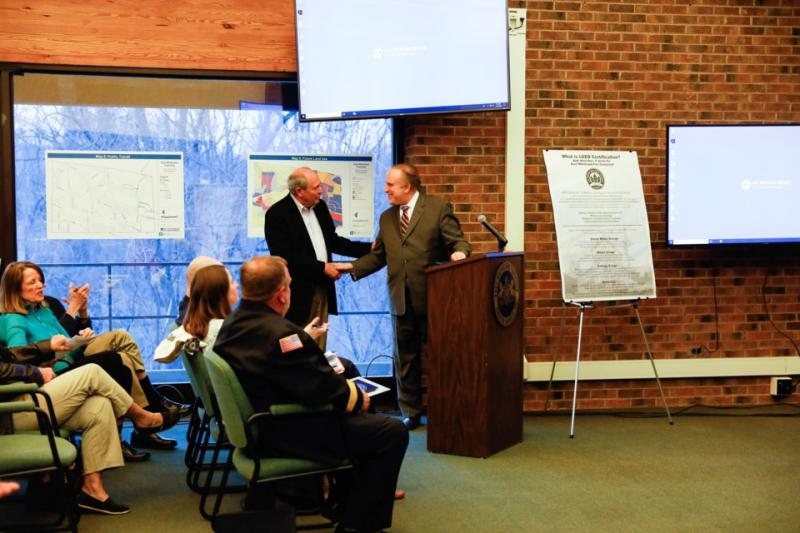 Photo Courtesy of Bernardon. Joe Rubino (left) and Senator Andy Dinniman share their congratulations during the East Whiteland Township board of Supervisors meeting on April 11th where the LEED Certification was announced.