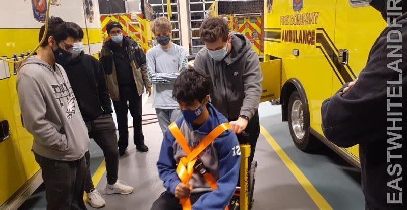 One of our junior members Dan Goncalves who is also an EMT demonstrates how to use a stair chair